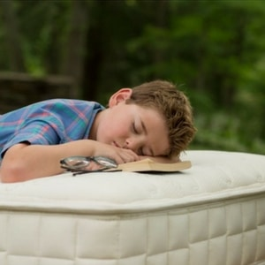 Child lying on organic kids mattress