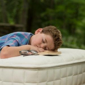 Child lying on organic kids mattress